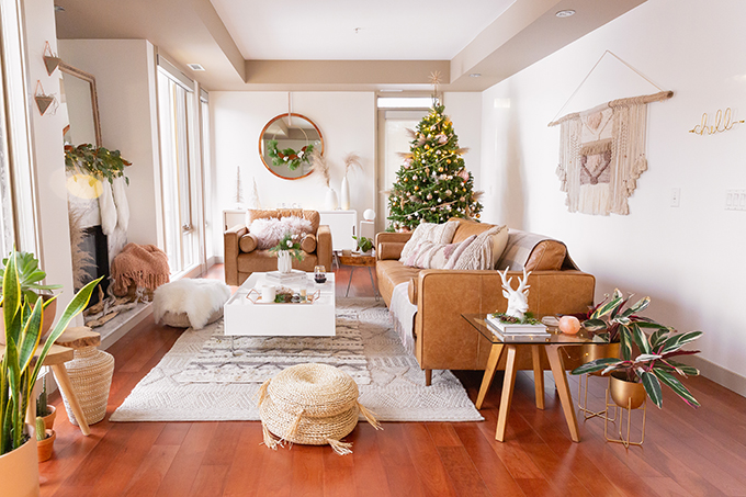Apartment Friendly Modern Holiday Decor   Real Christmas Tree with Wood Garland, Metallic and Wood Ornaments and Pampas Grass   Premium Nova Scotia Balsam Fir Tree   Bohemian, Mid Century Modern Holiday Decor   Bohemian Holiday Home Tour 2018   Caramel Mid Century Modern Leather Couches   Canadian Tire CANVAS Ornaments // JustineCelina.com