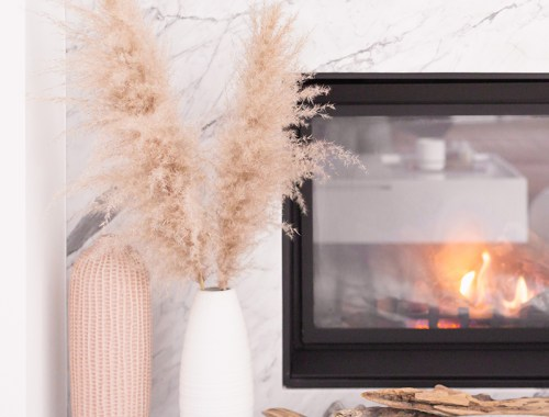February 2019 Soundtrack | A cozy, modern marble fireplace decorated with driftwood and vases with pampas grass | Bohemian, Mid Century Modern Decor | Calgary Lifestyle Blogger // JustineCelina.com