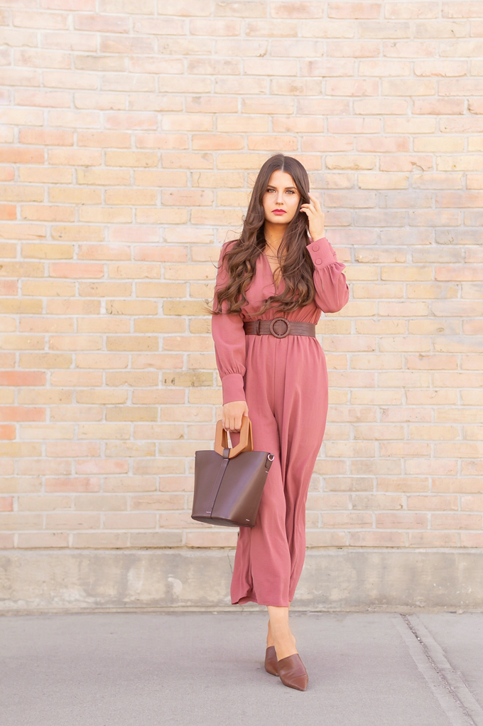 SPRING 2019 LOOKBOOK | Rosy Outlook: How to Style a Long Sleeve Mauve Jumpsuit for Spring | Jumpsuit Outfit Ideas Spring 2019 | How to Style a Jumpsuit for the Office | Brunette woman wearing a Long Sleeve Mauve Jumpsuit with a Brown Croc Embossed Bet styled, Zara Brown LEATHER MULES WITH GEOMETRIC HEELS and a Brown ZARA Wood Handled Structured Shopper against a brick wall | Top Spring 2019 Trends and how to wear them | Calgary Fashion & Creative Lifestyle Blogger // JustineCelina.com