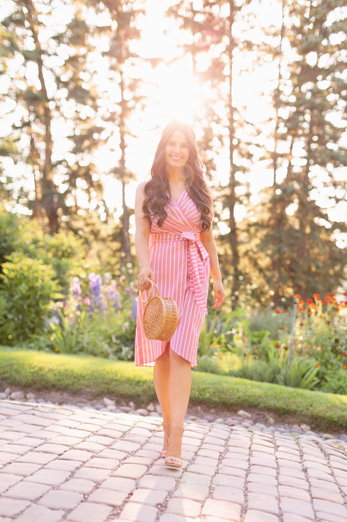 What to Wear to | A Casual Summer Wedding | Outdoor Summer Wedding Outfit Ideas | Brunette Woman wearing a Pantone Living Coral Wrap Dress with a Circular Bamboo Bracelet Bag | 3rd Floor Studio Isla Wrap Dress | How to Dress for a Casual Outdoor Summer Wedding | Summer Dresses to Wear to a Wedding | How to Wear Pantone Colour of the Year 2019 Living Coral | Reader Rock Park Calgary Wedding | Calgary Fashion and Lifestyle Blogger // JustineCelina.com