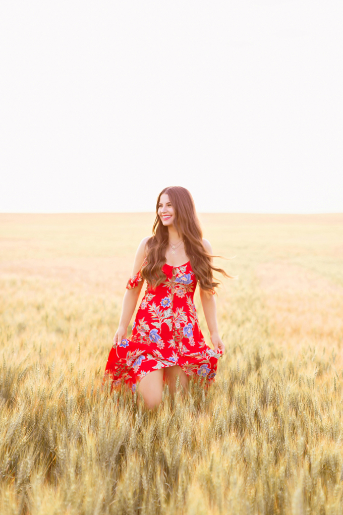 LATE SUMMER 2019 LOOKBOOK | Crimson and Clover: How to Style Maxi Dresses for Summer / Autumn | Red Maxi Dress Outfit Ideas | Bohemians Transitional Outfit Ideas | Brunette woman wearing a floral printed red maxi dress with nude espadrilles in a wheat field | Summer 2019 Trends | Canadian wheat field in Wheatland County, Alberta at Sunset | A Canadian Field of Wheat at Golden Hour | Calgary, Alberta, Canada Lifestyle and Fashion Blogger, Justine Celina Maguire | JustineCelina.com