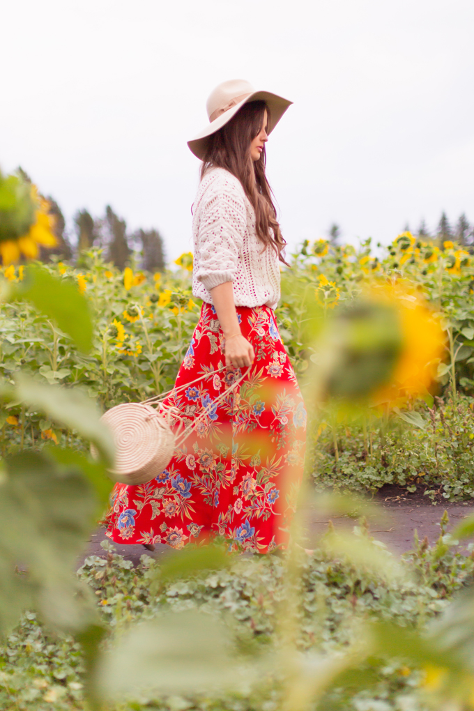 LATE SUMMER 2019 LOOKBOOK | Crimson and Clover: How to Style Maxi Dresses for Summer / Autumn | Red Maxi Dress Outfit Ideas | Bohemians Transitional Outfit Ideas | Brunette woman wearing a floral printed red maxi dress with a fisherman's knit sweater, floppy felt tan hat and a woven round bag in a sunflower field | Canadian sunflower field in Alberta at Sunset | Bowden Sunmaze Review | Calgary, Alberta, Canada Lifestyle and Fashion Blogger, Justine Celina Maguire | JustineCelina.com