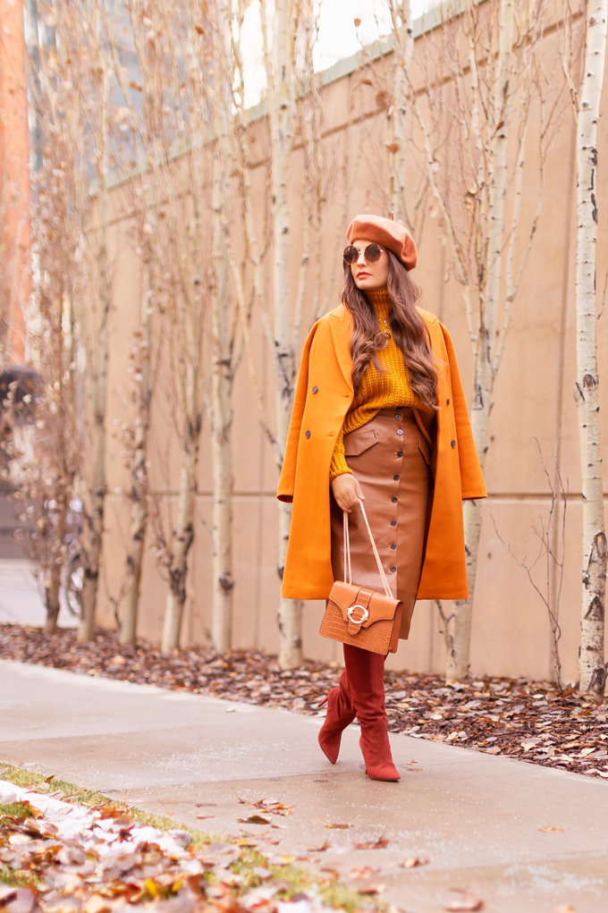 Autumn 2019 Lookbook: Pumpkin Spice | Top Fall / Winter 2019 Trends | Top Autumn 2019 Trends and How to Wear Them | Brunette woman wearing an orange coat with an H&M faux leather skirt, chunky mustard sweater, beret, rust suede boots and a croc embossed bag | Chic Fall / Winter 2019 Outfits | How to Wear the Pantone AW19/20 Fashion Colour Trend Report | How to Style a Faux Leather Skirt | How to Wear a Beret | Orange Monochromatic Outfit |  Top Calgary Fashion Blogger // JustineCelina.com
