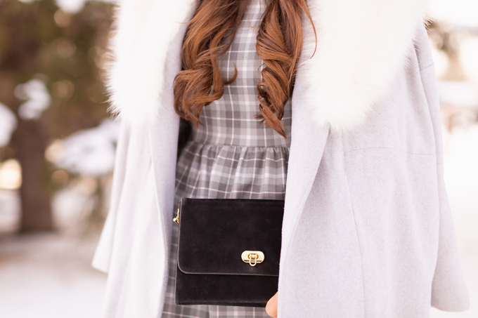 Autumn / Winter 2019 Lookbook: Grey Area | Top Fall / Winter 2019 / 2020 Trends | Top Winter 2019 Trends and How to Wear Them | Brunette woman wearing a grey plaid babydoll dress, grey Paisie Coat with a White Faux Fur Collar, Black Suede Over The Knee Boots and a vintage suede bag in an snow covered park with trees| Monochromatic Grey Outfit | Festive Winter Holiday Outfit | Canadian Winter Outfit Ideas | Top Calgary Fashion & Creative Lifestyle Blogger // JustineCelina.com