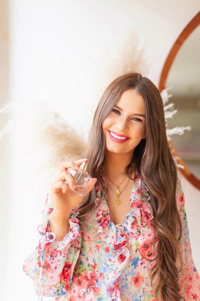 My Favourite Floral Fragrances | The Best Floral Fragrances for Spring | Floral Fragrances 2020 | The Best Luxury Floral Fragrances | Designer Floral Fragrances 2020 | Classic Floral Perfumes | Best Floral Perfumes of all Time | Best Fruity Perfumes | Citrus Floral Perfumes | Mon Guerlain Eau de Parfum Photos and Review | Brunette woman holding a bottle of Mon Guerlain Eau de Parfum | Calgary, Alberta Beauty & Lifestyle Blogger // JustineCelina.com
