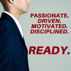 "Business man focused on the words: ""Passionate. Driven. Motivated. Disciplined. Ready."""