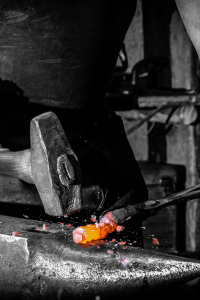 Blacksmith forging iron