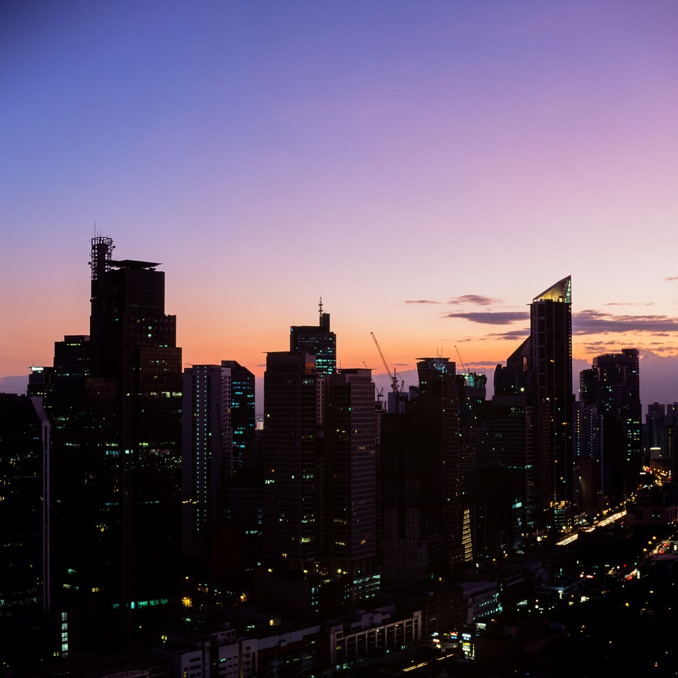 The oranges and purples come in for sunset over Metro Manila in the Philippines.