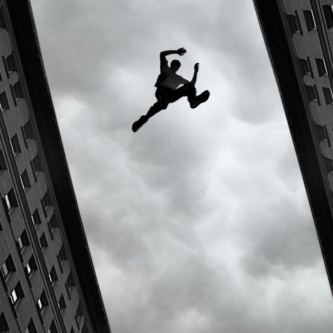transition-man-jumping-over-building