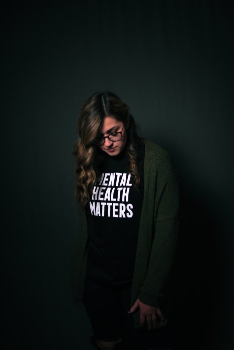 Female wearing Mental health Matter T-shirt