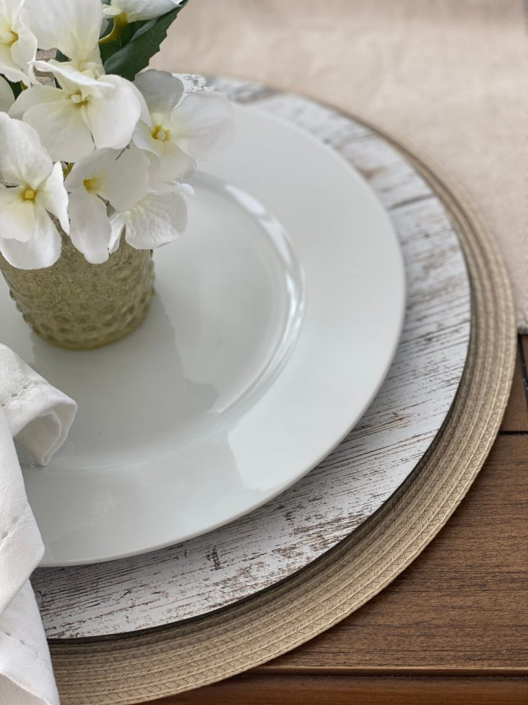 white plates layered with neutrals for a pretty decor look