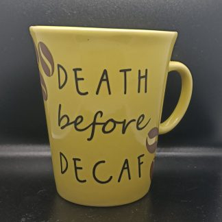 mug with death efore decaf quote and coffee beans