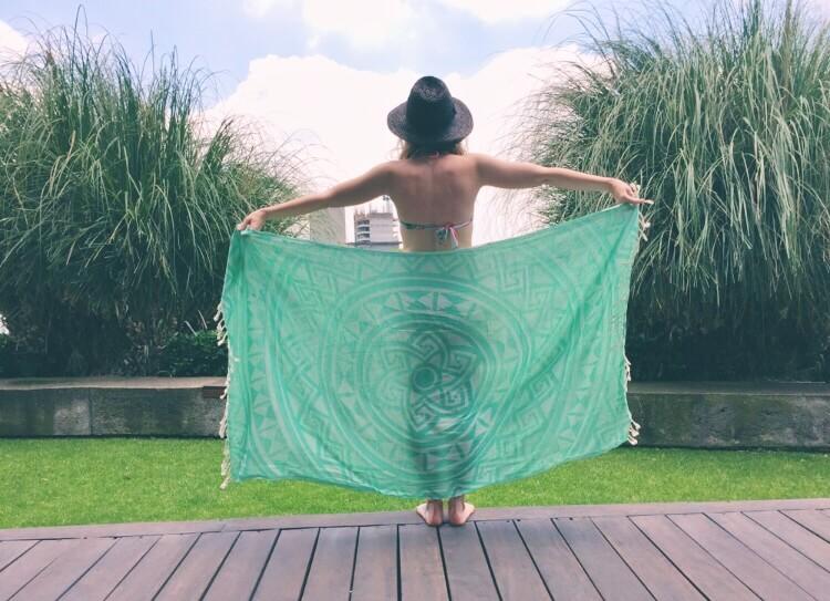 Sunbathing girl with Turquoise Sand Cloud Towel