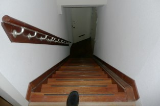 The stairs from the apartment to the front door