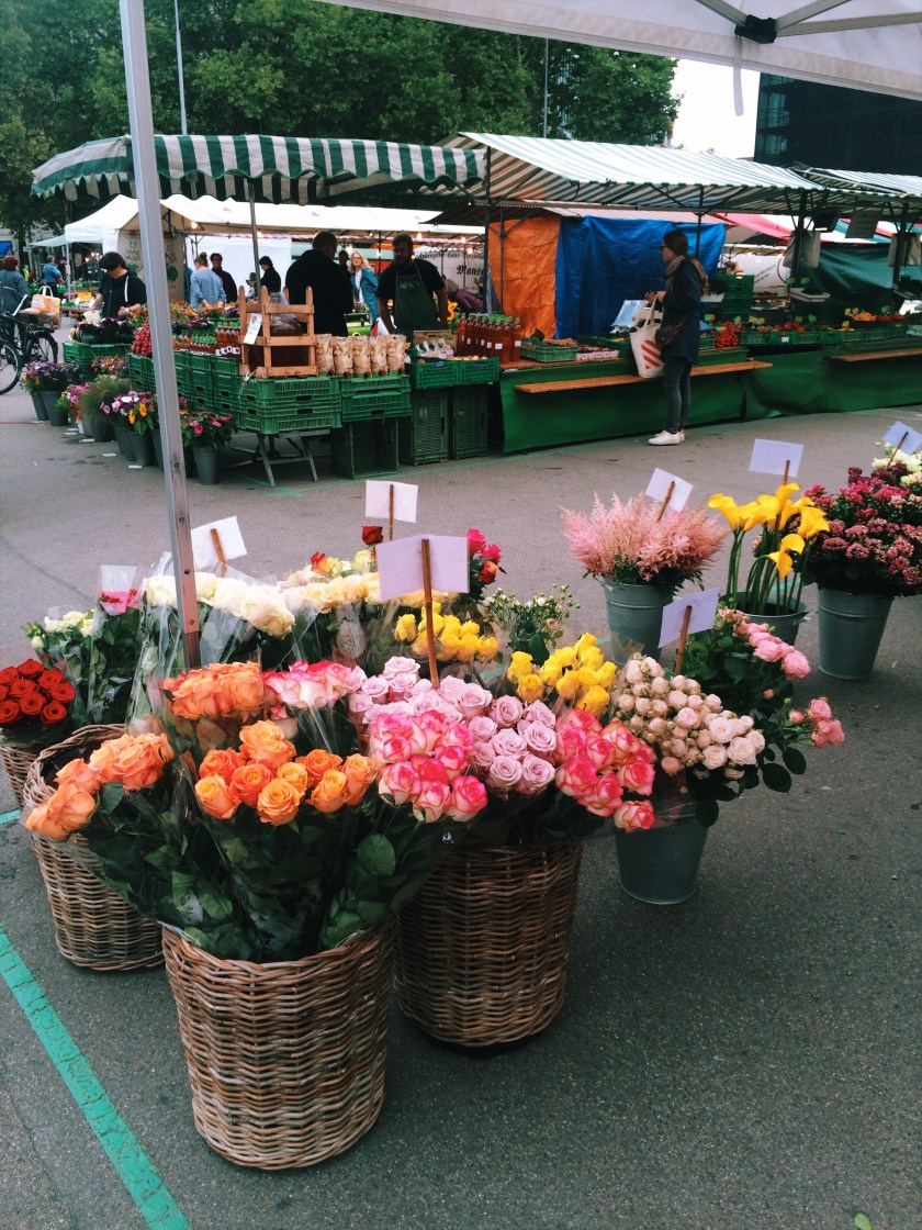 Fresh flower stalls at Helvetiaplatz Farmers Market in Zurich