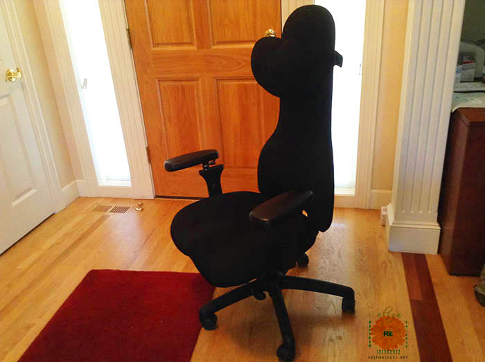 image of an empty black office chair on a hardwood floor