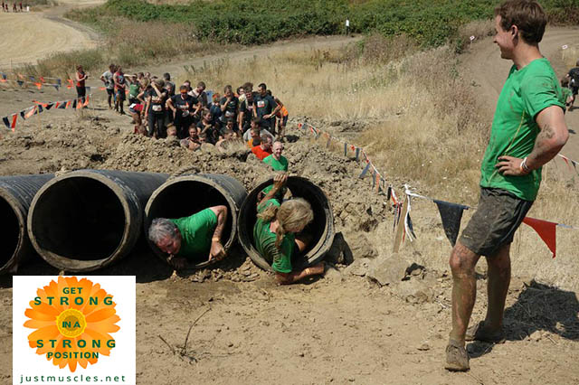 Image of Laura Coleman and team members exiting the barrel obstacle
