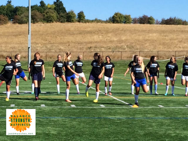 Image of a girls Soccer team warming up