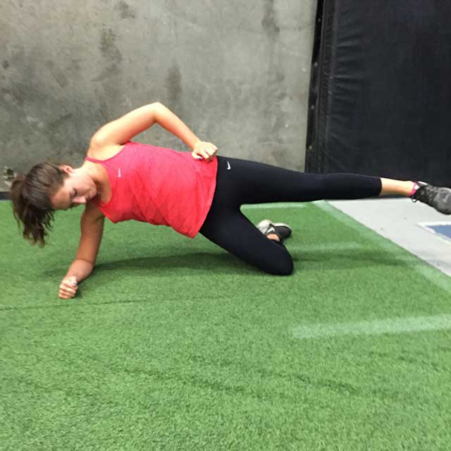 Image of woman doing a sideway plank exercise with Laura Coleman