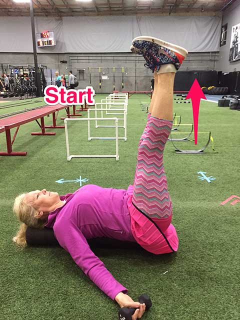 image of Laura Coleman demonstrating straight leg drop exercise for stomach and abs