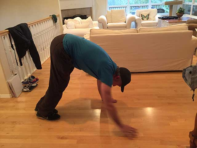 Image of a man doing an inchworm exercise