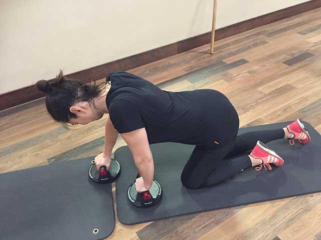 image of woman crawling forward