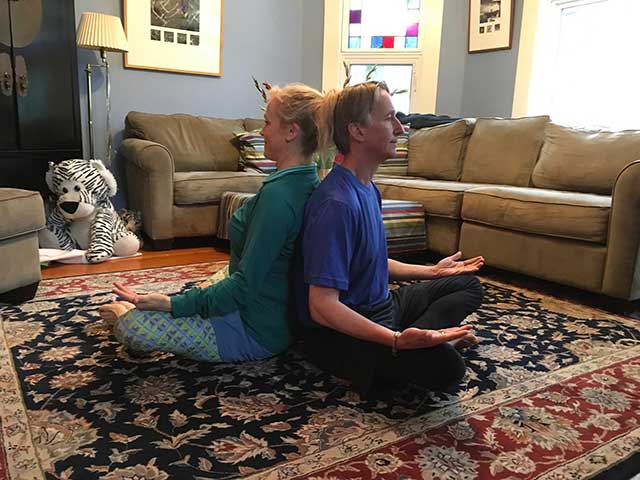 image of partner yoga with palms up