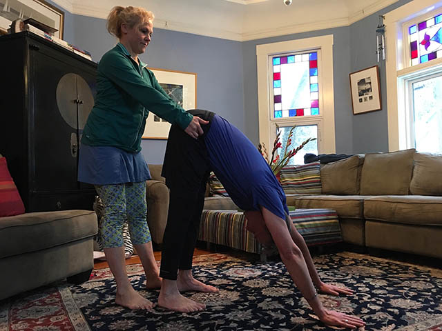 Image of personal trainer, Laura Coleman doing a partner back stretch