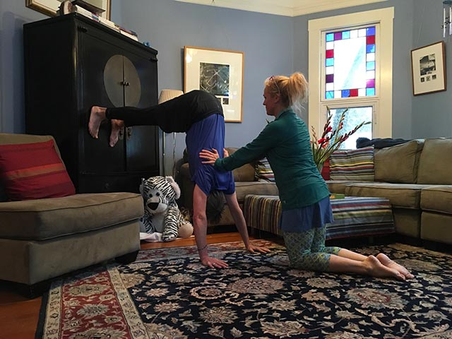 Image of personal trainer, Laura Coleman doing a partner inversion stretch
