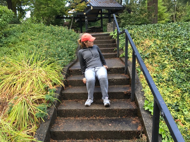 Image of woman doing crab walk exercise on stairs