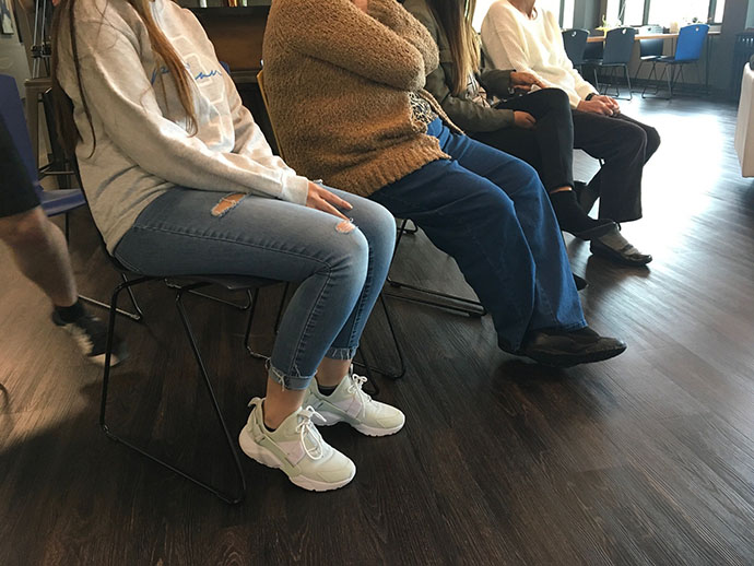 image of a row of people sitting showing knee and foot positions