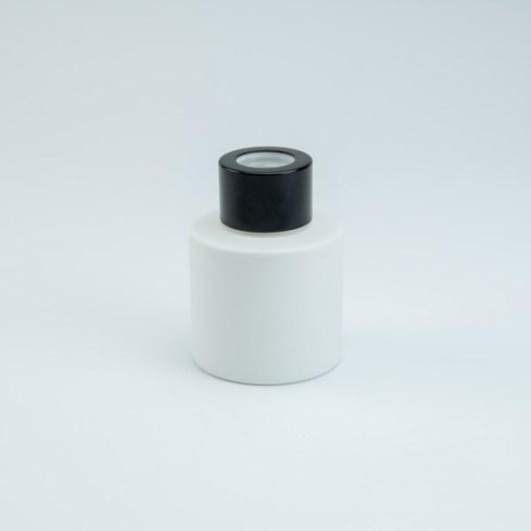 Verpakking: Parfumflesje wit met zwart schroefdeksel