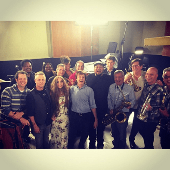 Lady Gaga and Paul McCartney and his group in the recording studio