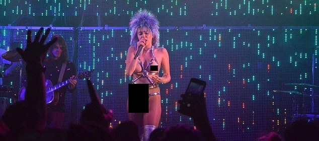 miley cyrus milky milky milk tour breasts and strap on dildo