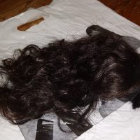 14 inches of Black and Brown Virgin hair.