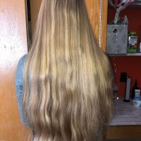 "10"" of virgin golden blonde hair with natural highlights"