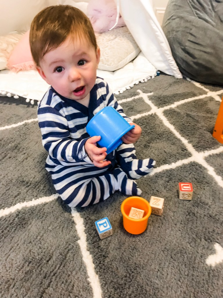 Your 6 to 9 month old baby is advancing in their development drastically. Find a ton of activity ideas for your developing baby to improve play skills from fine motor, cognitive, problem solving, and language. In this age range they will master sitting and may even start crawling and saying their first words.