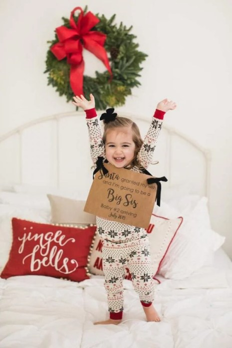 Awesome and festive Christmas pregnancy announcements for adorable siblings announcing they're a big brother or sister this holiday season.