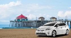Toyota Prius on the beach near Huntington Beach Pier