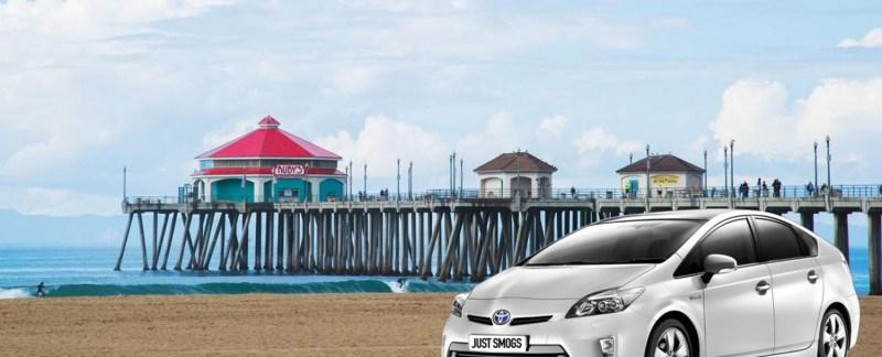 Toyota Prius on the beach near Huntington Beach Pier