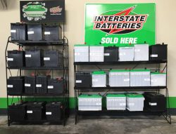 Battery racks containingt Intertate brand car and truck batteries.