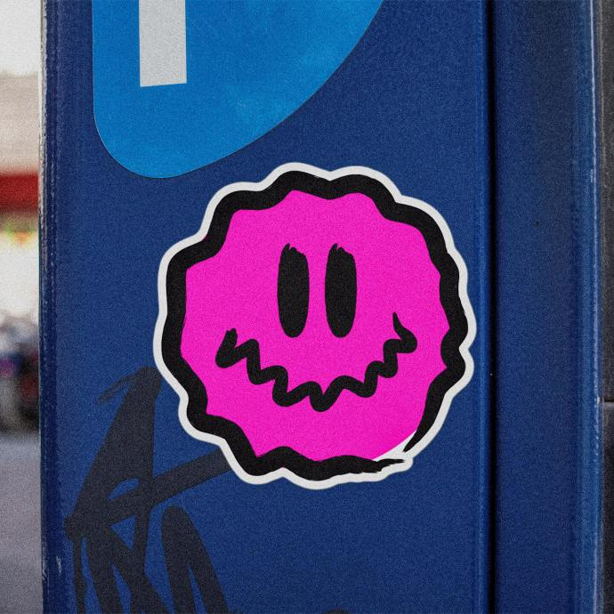 square-pink-antsy-face-round-sticker-on-a-blue-parking-meter.
