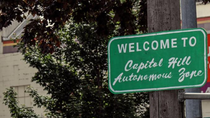 """A sign marking the border of the """"Capitol Hill Autonomous Zone"""" in Seattle, Washington"""