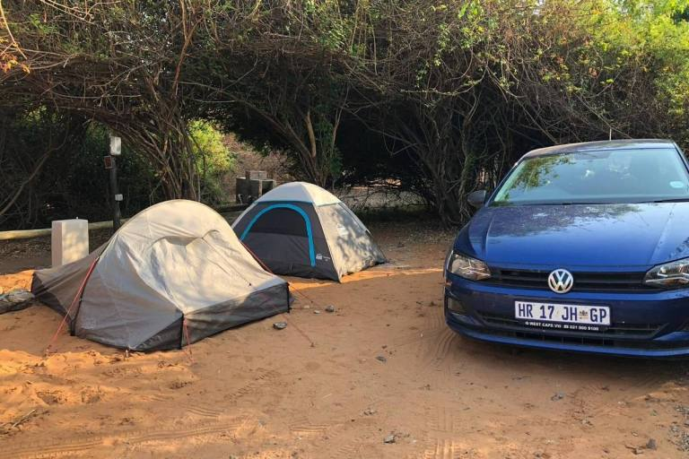 Rental car and tents set up at camp in Kasane