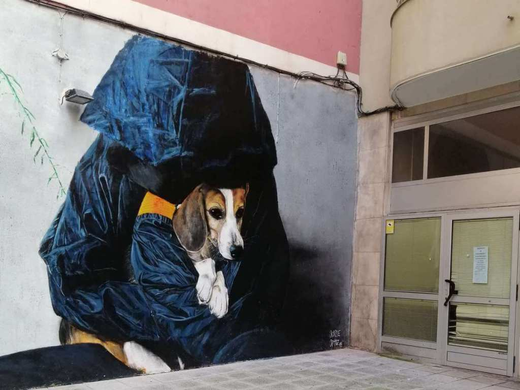 Street art of a person and their dog on Calle Valliciergo