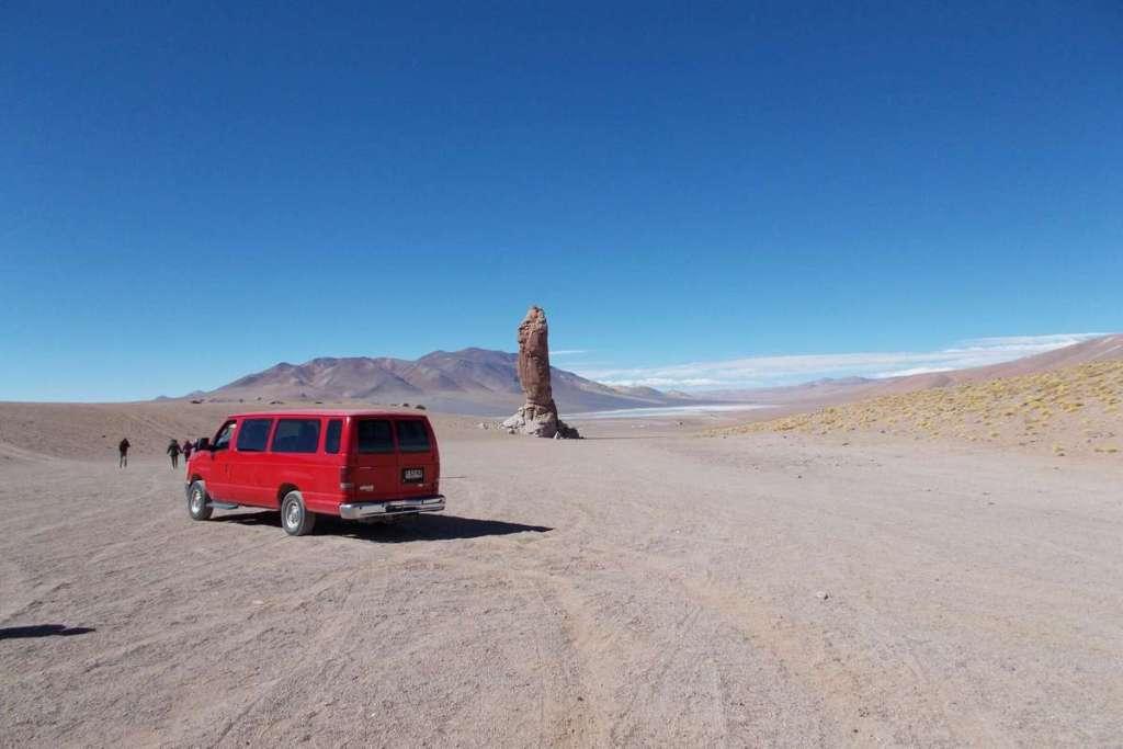 Red van with the Atacama Desert behind