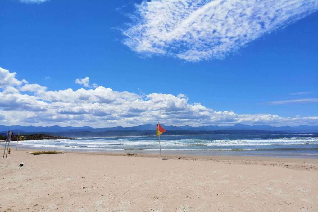 Plettenberg Bay beach with distant mountains