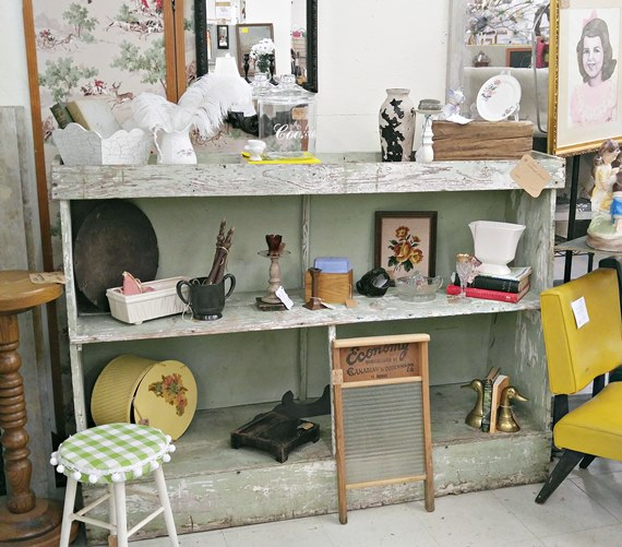 Decorating an antique booth in Angel's Antique Mall