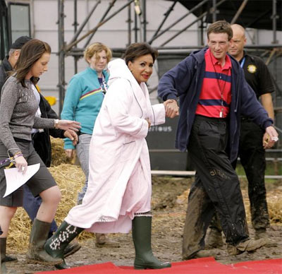 Dame Shirley enters the mud wrestling ring at Glastonbury in 2005