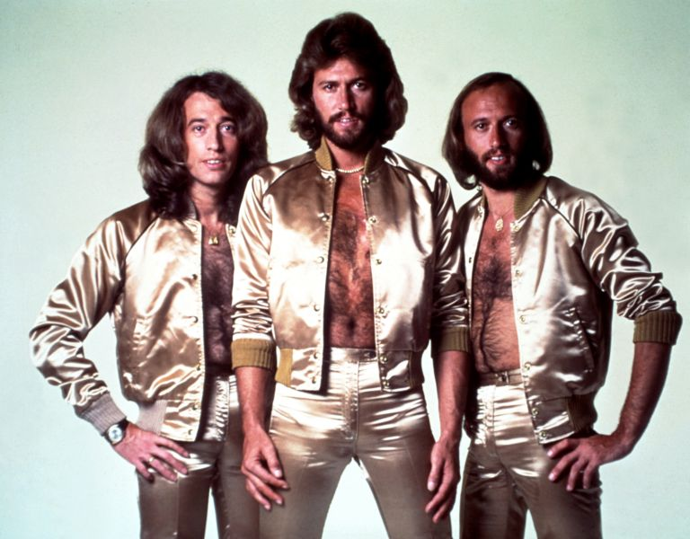The Gibb boys prepare for the Christmas number one by wrapping themselves in Bacofoil like Turkeys